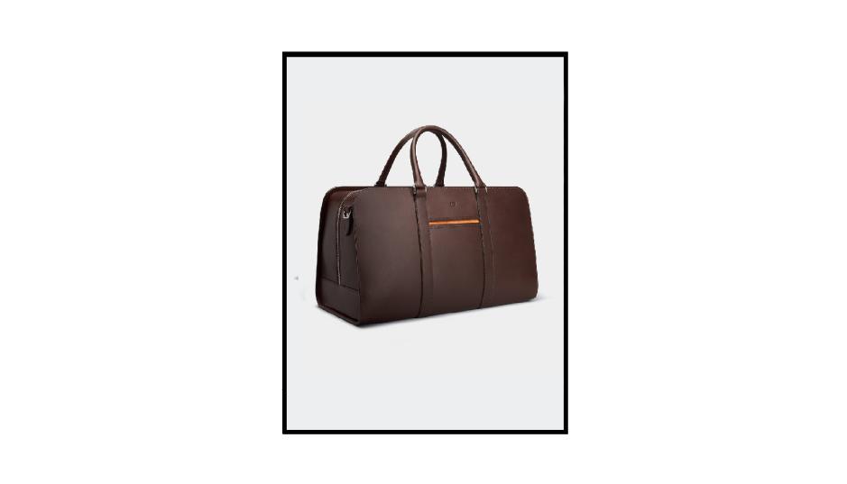 leather weekend bag by carl friedrik